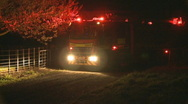 Fire truck attends fire at night Stock Footage