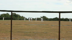 Cricket through boundry fence 2 Stock Footage