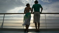 Couple stands on deck of cruise ship and talks Stock Footage