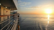 Stock Video Footage of sunrise on sea, view from moving cruise ship