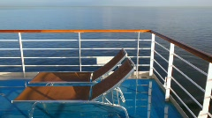 pair of deckchairs on deck of cruise liner - stock footage