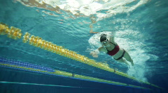 female swimmer in indoor swimming pool - stock footage