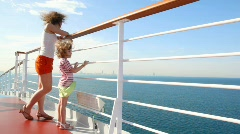 Mother and daughter stands on deck of cruise ship Stock Footage