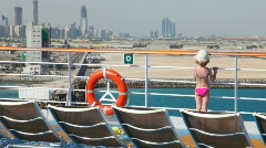 Girl stands on deck of cruise liner Stock Footage