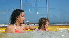 Mother and daughter in hot whirlpool on deck of ship Stock Footage