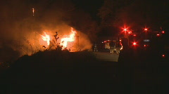 Burning shed and fire trucks Stock Footage