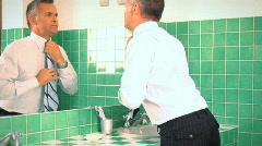 Businessman grooming in bathroom Stock Footage