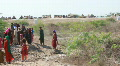 Refugees Outside Flood Relief Camp in Pakistan Footage