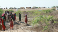 Stock Video Footage of Refugees Outside Flood Relief Camp in Pakistan