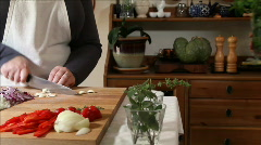 Chef cutting herbs other woman walks in Stock Footage