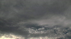 Timelapse clouds fade dark as they move away from cam Stock Footage