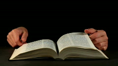 Hands and book - stock footage
