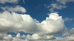 White clouds running over blue sky - stock footage