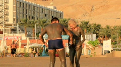 Dead Sea. Mud therapy Stock Footage