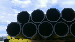 Pipes stacked in construction site dolly shot  Stock Footage