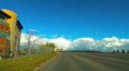 Drivers view car driving on bridge over bow river bright blue sky Stock Footage