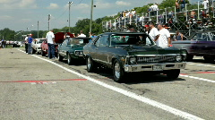 Classic cars at drag strip Stock Footage