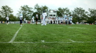 Sideline of Children's Football Game Stock Footage
