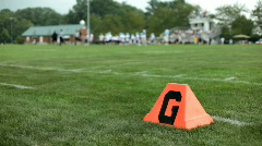 Goal line of Field with team walking off Stock Footage