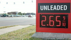 Unleaded Gas sign next to road Stock Footage