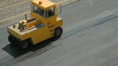 Compactors Flattening Asphalt Stock Footage