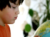 Young boy looking at the globe Stock Footage