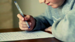 Young boy doing homework Stock Footage