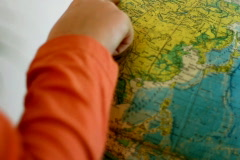 Finger pointing on the globe Stock Footage