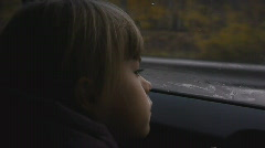 Stock video footage girl in car autumn - stock footage