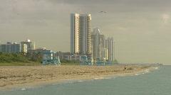 Man runs on Miami beach Stock Footage