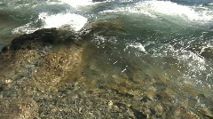 Rapid river water stream liquid flowing rocky shore wet white green brown aud Stock Footage