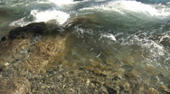 Stock Video Footage of rapid river water stream liquid flowing rocky shore wet white green brown aud