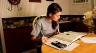 High school girl doing homework - dolly Stock Footage