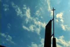 Time lapse clouds and church cross - stock footage