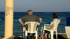 Pensioners by sea Stock Footage