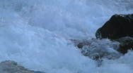 Frothing White Water Rapids zoom out Reveals Rocky Canyon Mountain River Stock Footage