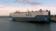 A Giant Cargo Ship Gets Ready To Dock at a Port in the Bahamas 2 Stock Footage