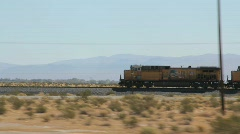 Stock Video Footage of Train Races through the Desert