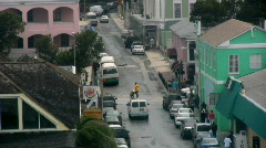 Stock Video Footage of a Long Shot of the City of Nassau in the Bahamas People Walking and Driving 5