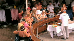 People On a Cruise Ship Watch The Workers Prepair an Outdoor Meal Stock Footage
