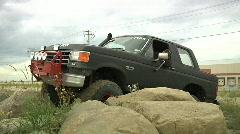 Ford bronco backing off sandstone rocks power pole Stock Footage