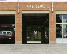 Fire engine arriving at fire station Stock Footage