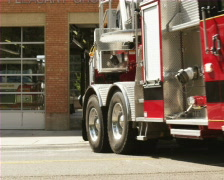 Fire engine leaving garage Stock Footage