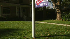 Sold sign in front of suburban house Stock Footage