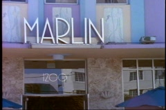 "Miami, South Beach, close up of art deco hotel sign, ""Marlin"" pan left Stock Footage"