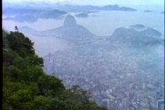 Rio de Janeiro, wide shot atop Corcovado, hazy, smoggy, distant city view Stock Footage