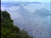 Stock Video Footage of Rio de Janeiro, wide shot atop Corcovado, hazy, smoggy, distant city view