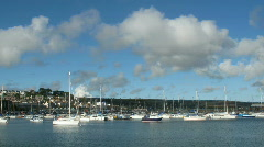 Penzance harbour boats white clouds Stock Footage