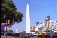 Buenos Aires, Argentina, obelisk, taxi's passing, Plaza de la República Stock Footage