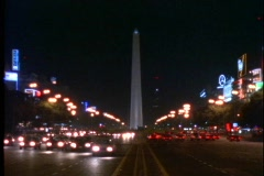 Stock Video Footage of Buenos Aires by night, Argentina, obelisk, traffic, Plaza de la República